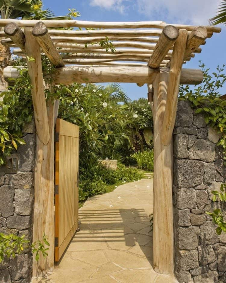 Wooden arbor garden with stone pathway